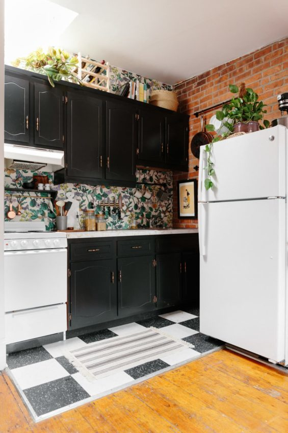 Various things stored in the space above a kitchen cabinet