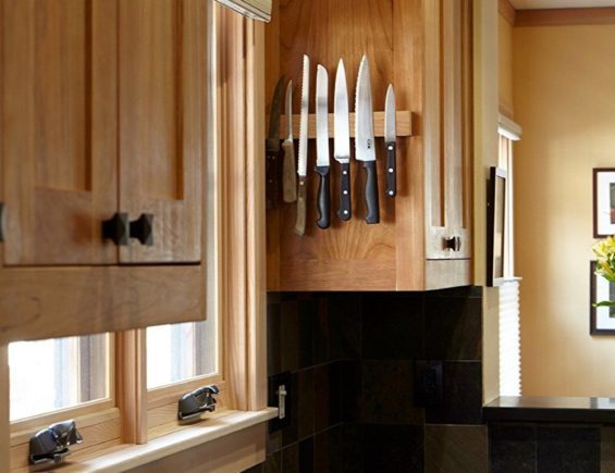 Magnetic knife holder on the side of the cabinet