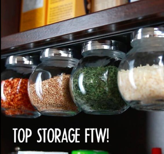 Food jar lids attached to cabinet shelf with the help of magnets