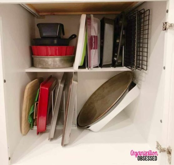 Cookie sheets and baking trays stacked vertically