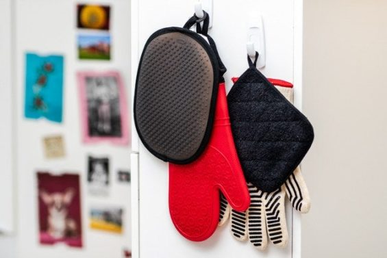 Oven mitts and hot pads hanging on hooks
