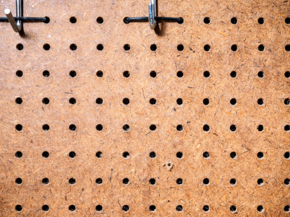Use a peg board for hanging utensils