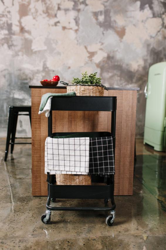 Rolling storage cart in kitchen