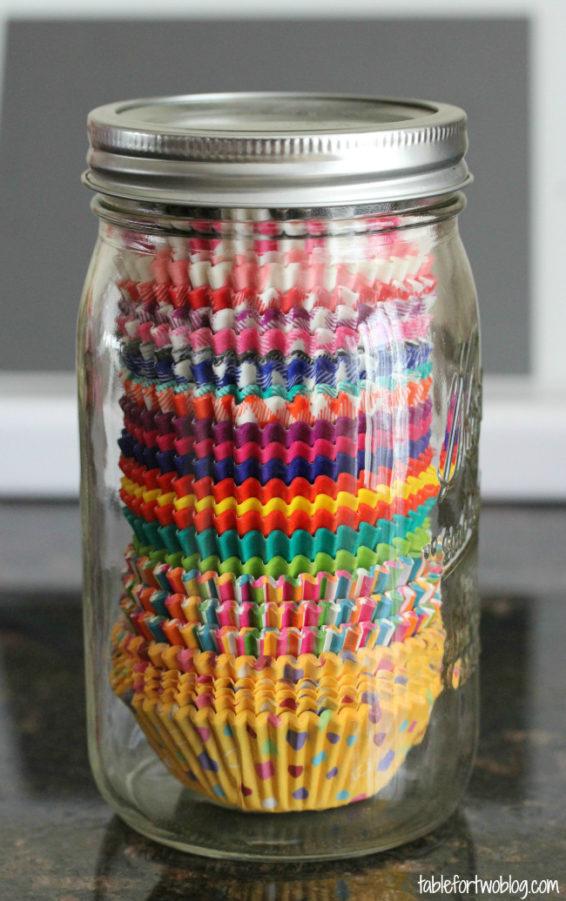 Colorful cupcake liners inside a mason jar