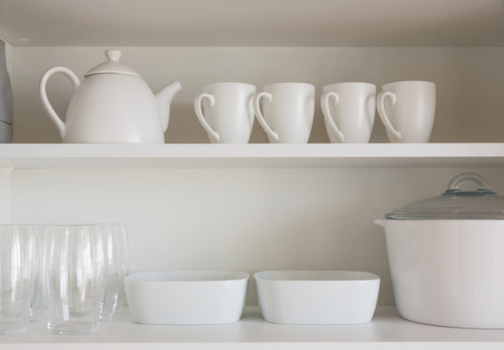 White and glass kitchenware on open shelving